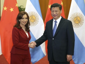 Chinese President Xi Jinping shakes hands with Argentine President Cristina Fernandez de Kirchner during their talks in Beijing Feb 3, 2015